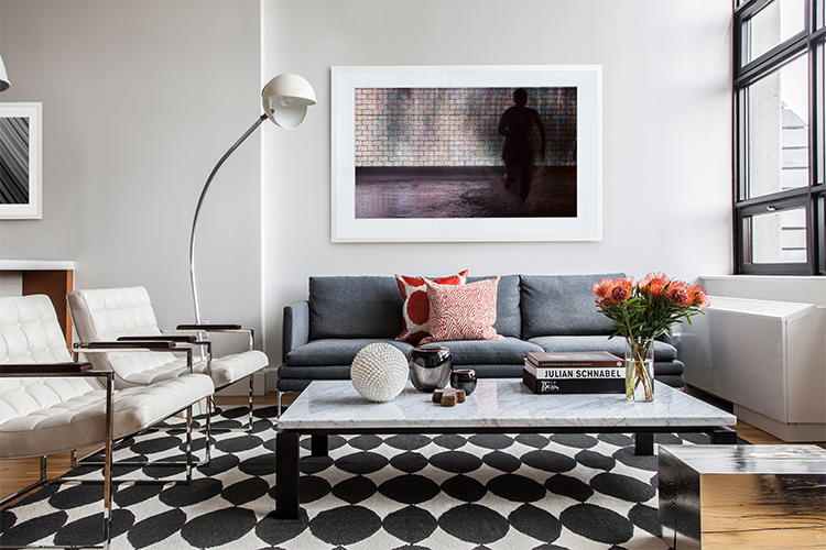 Sofa by Zanotta and chairs by Room. Rug from Dwell Studio and floor lamp is vintage from Gueridon.