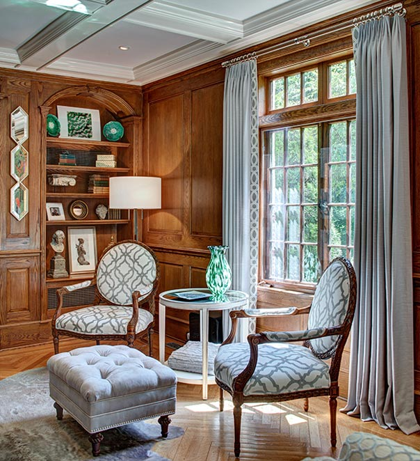 Transom Windows Provide A Sunny Reading Corner Complete With Pair Of French Chairs And
