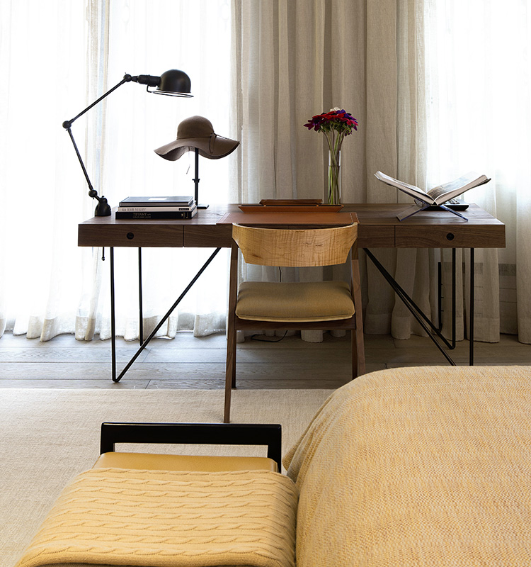 The writing table and chair in the master bedroom provides a quiet spot to jot in journals and pen letters.