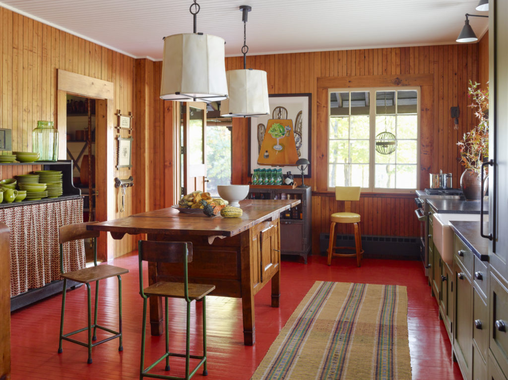 A Coat Of Cheery Red Warms Up The Kitchen Giving New Life To Rooms Damaged Original Floors Vellum Skin Lampshades From Roman Thomas Give Off