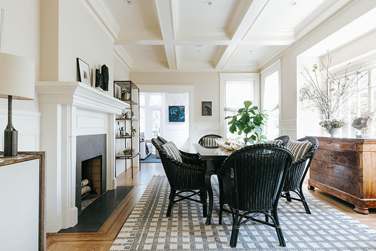 A Bar By Brett Design Woven High Back Bistro Chairs And Simply Patterned Holland Sherry Rug Take The Formal Dining Room Into Relaxed Territory