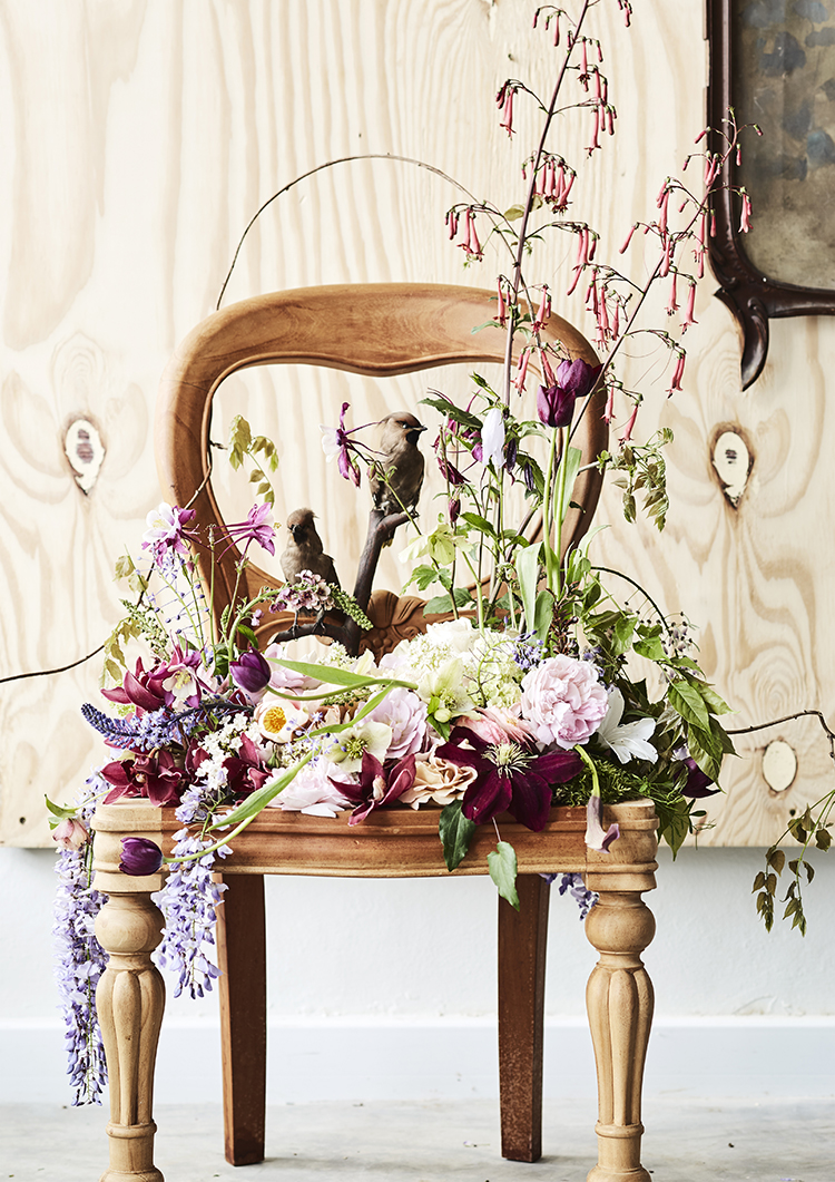floral arrangement on wooden chair