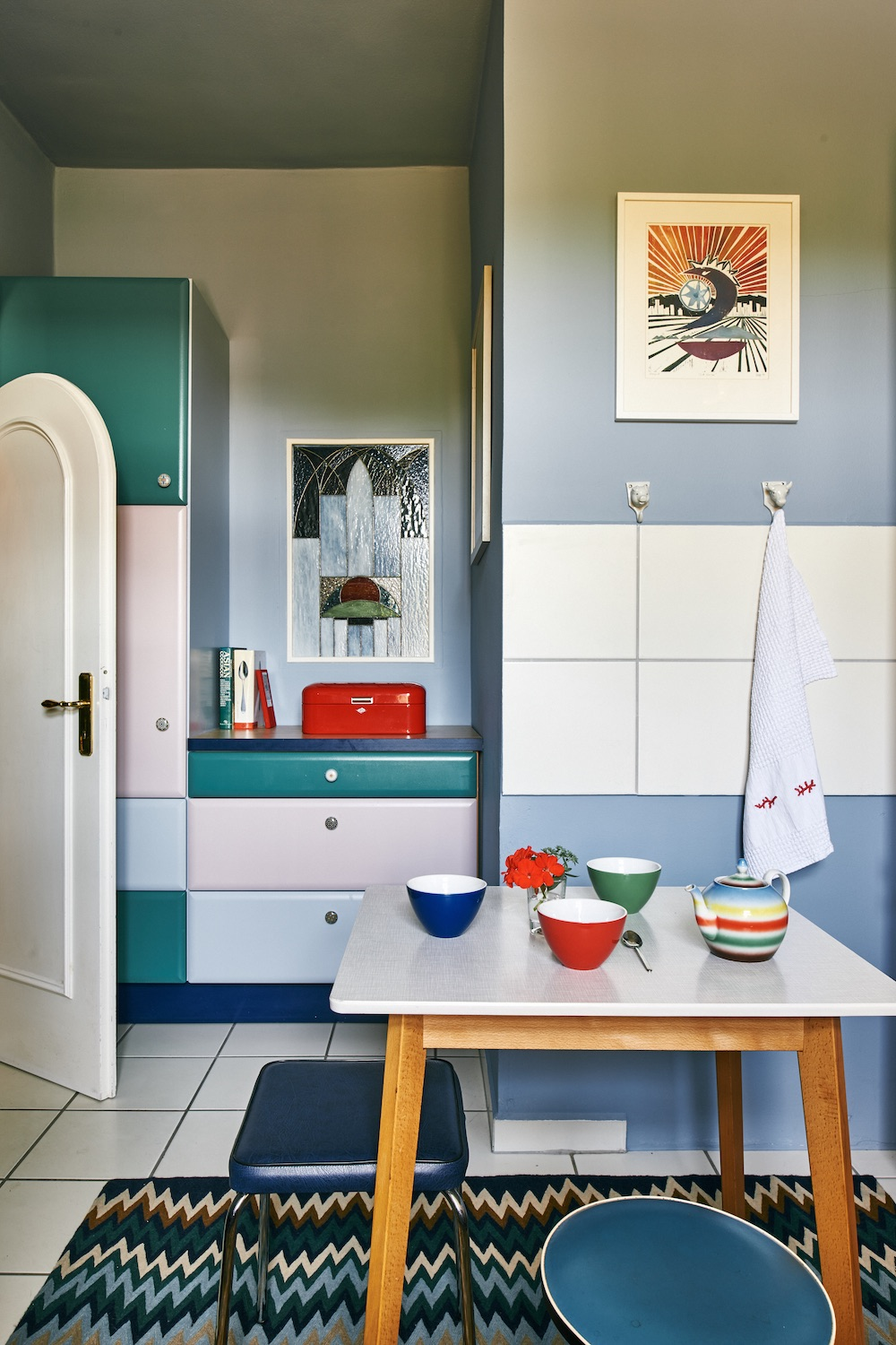 midcentury modern kitchen with color blocked cabinets