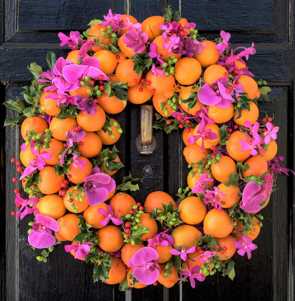 holiday wreaths made with oranges and fresh orchids