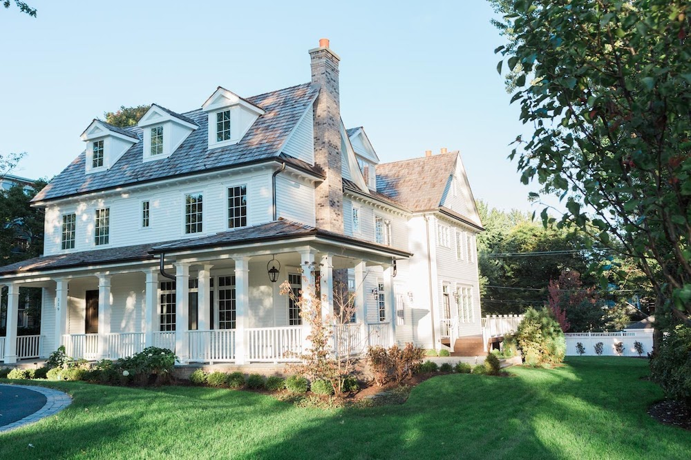 exterior- white 1900s traditional Hinsdale home with wraparound porch