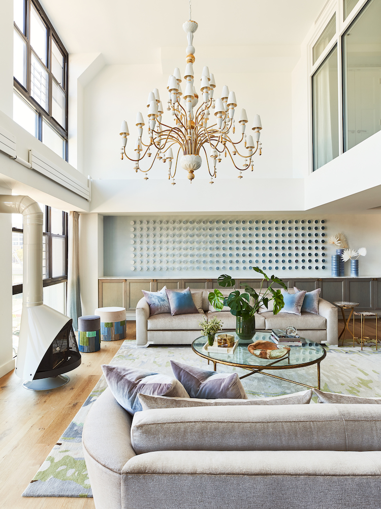 two brooklyn duplexes merged to expand the ceilings in this living room
