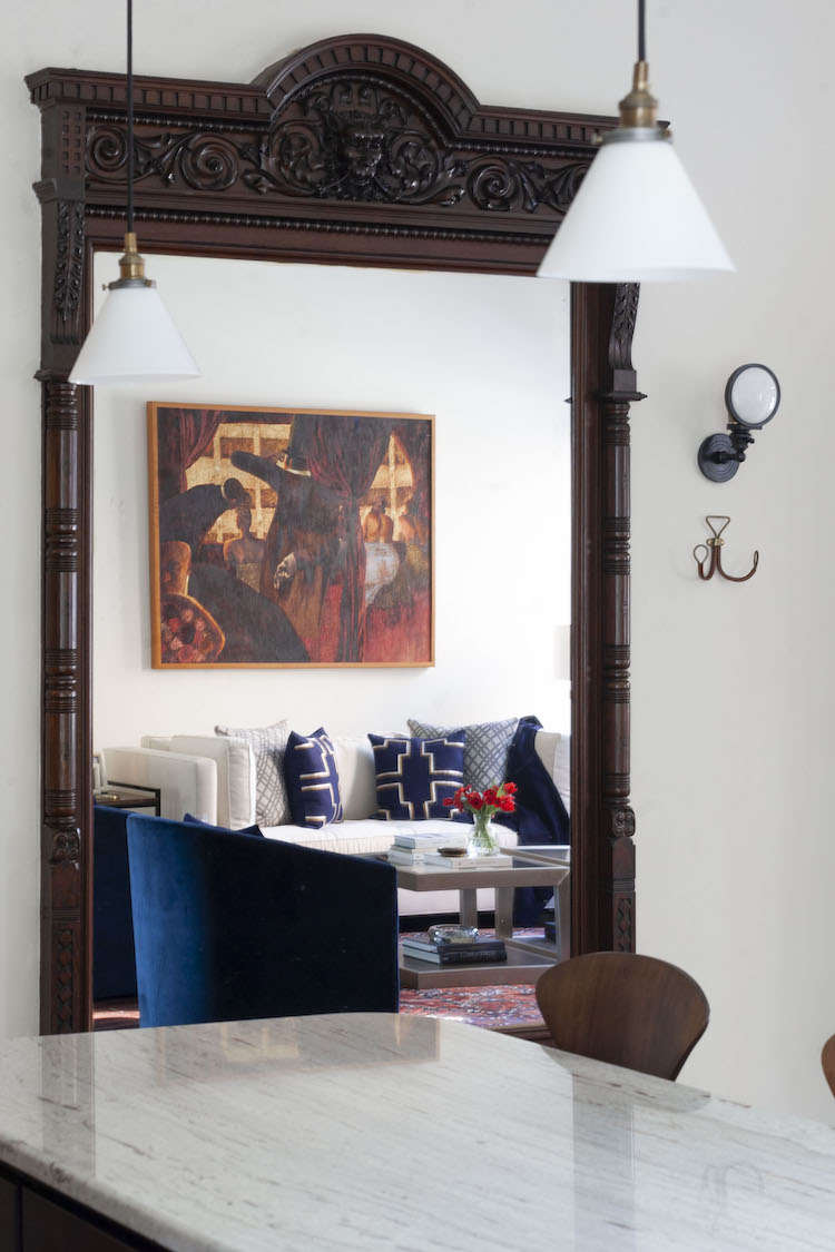 an antique mirror reflects the living room in a rittenhouse square home