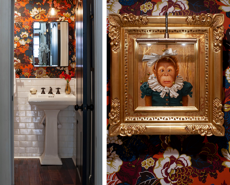 a busy floral wallpaper in oranges and blues covers the bathroom in a rittenhouse square townhouse